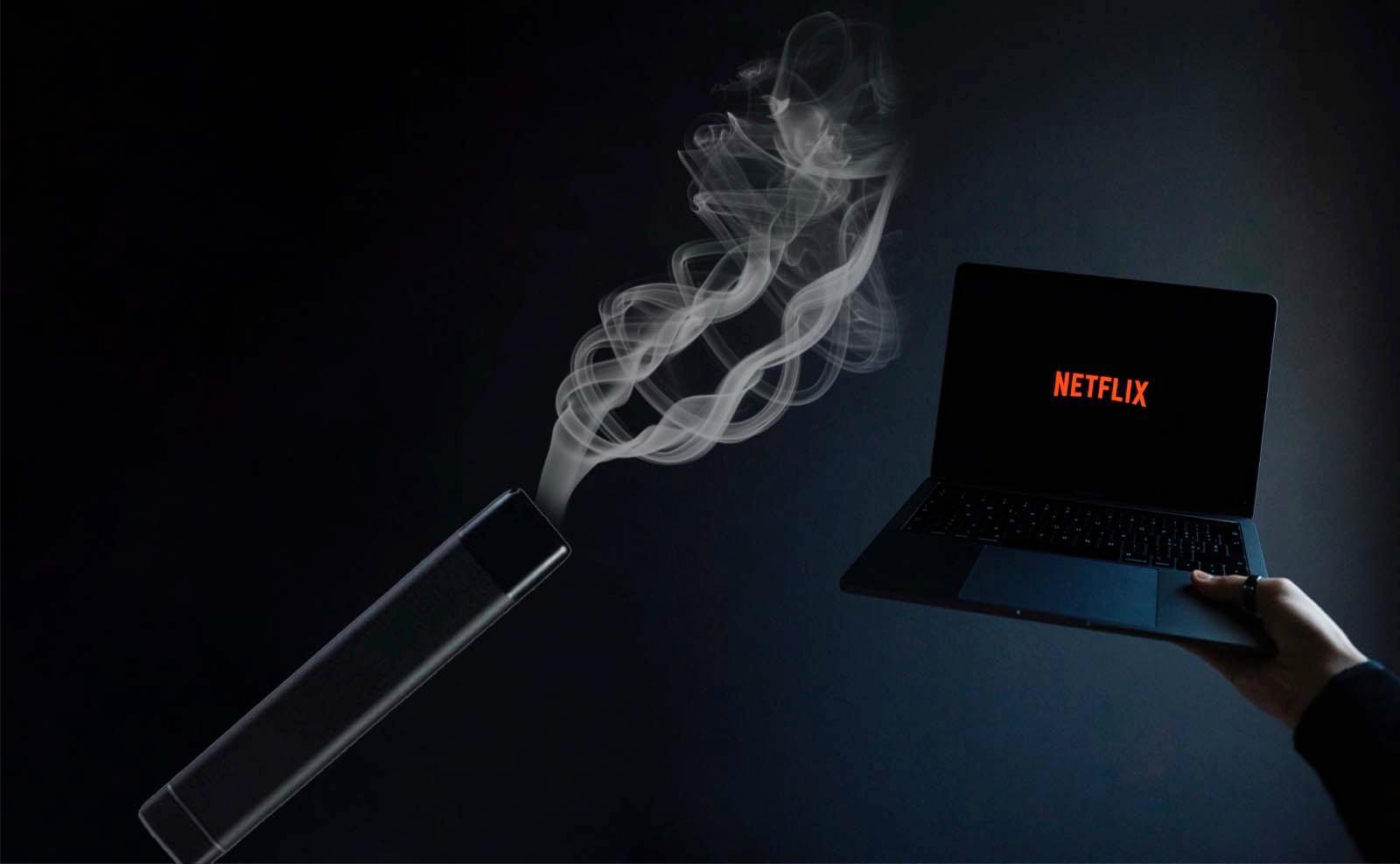 Laptop deschis cu Netflix și tigara electronică YOOP